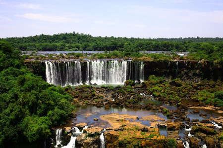 The Iguassu (or Iguazu) Falls is one of the largest masses of fresh water on the planet and divides, in South America, Brazil, Paraguay and Argentina. The waterfall system consists of 275 falls along 2.7 kilometres (1.67 miles) of the Iguazu River. Some o photo