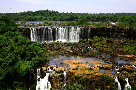 largest: The Iguassu (or Iguazu) Falls is one of the largest masses of fresh water on the planet and divides, in South America, Brazil, Paraguay and Argentina. The waterfall system consists of 275 falls along 2.7 kilometres (1.67 miles) of the Iguazu River. Some o