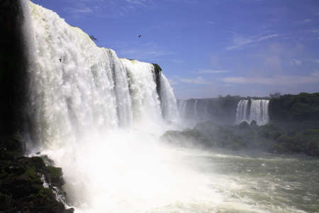 kilometres: The Iguassu (or Iguazu) Falls is one of the largest masses of fresh water on the planet and divides, in South America, Brazil, Paraguay and Argentina. The waterfall system consists of 275 falls along 2.7 kilometres (1.67 miles) of the Iguazu River. Some o