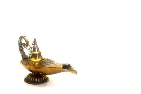 An isolated golden or bronze magic genie lamp, like Aladdins! :)