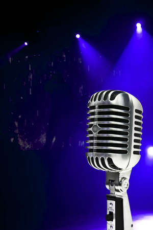A retro, 60's style,metallic microphone on a colorful background. Standard-Bild