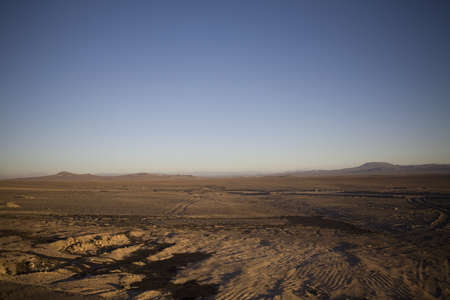 rainless: The Atacama Desert is a virtually rainless plateau in South America, covering a 966 km (600 mi) strip of land on the Pacific coast of South America, west of the Andes mountains. The Atacama is the driest desert in the world. Stock Photo