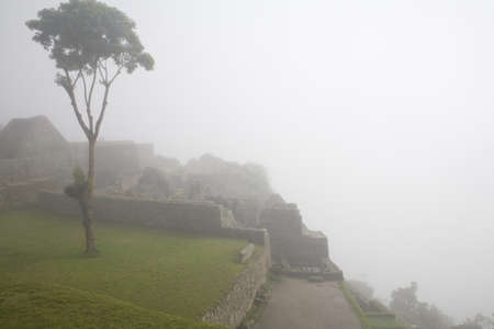 Machu Picchu is a pre-Columbian Inca site located 2,430 metres (8,000 ft) above sea level. It is situated on a mountain ridge above the Urubamba Valley in Peru, which is 80 kilometres (50 mi) northwest of Cusco and through which the Urubamba River flows.  photo