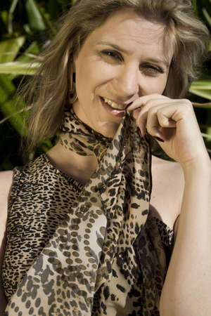 A very pretty and young blond brazilian woman wearing a leopard skin like blouse. Stock Photo - 4903119