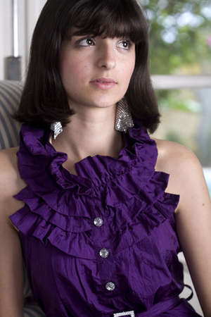 18 year old: An 18 year old exotic brazilian model, with short dark hair, a young looking face and a skinny body. She is wearing a purple shirt. Stock Photo