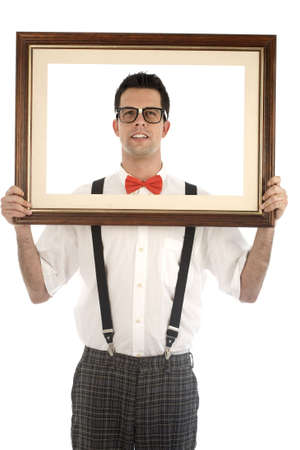 suspender: A young, caucasian nerd, holding up a frame, isolated on a white background. Stock Photo