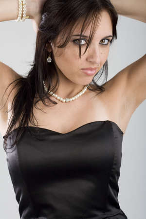 A very sexy young brazilian brunette model shot in a studio. photo