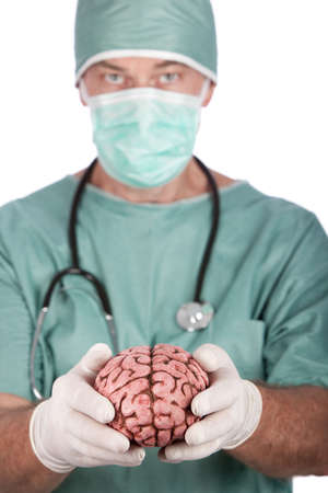 A 60 year old surgeon holding a brain, isolated on a white background.