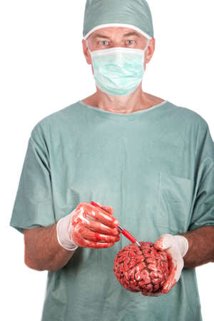 A 60 year old surgeon pointing to a bloody brain. photo