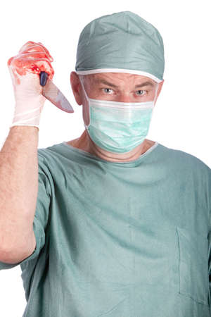 A 60 year old surgeon holding a bloody nice. Malpractice concept. photo