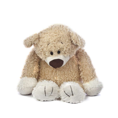 An adorable teddy bear that is sad and hurt. Stock Photo