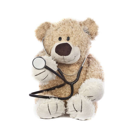 An adorable teddy bear, isolated on white, holding a stethoscope.
