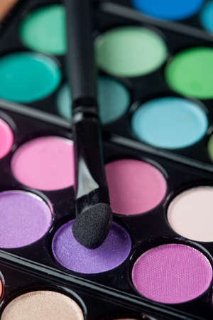 A colorful image on an eyeshadow pallet with a brush. photo