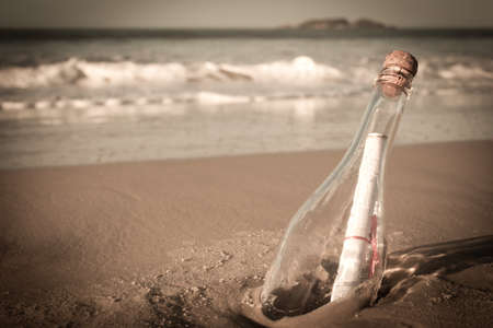 A message inside a glass bottle, washed up on a remote beach. Stock Photo - 13832519