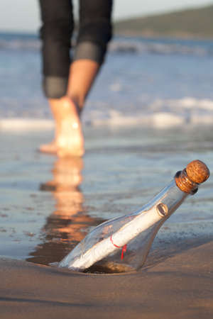 A message inside a glass bottle, washed up on a remote beach. Stock Photo - 13832521