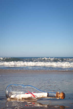 A message inside a glass bottle, washed up on a remote beach. Stock Photo - 13943063