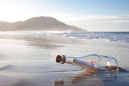 A message inside a glass bottle, washed up on a remote beach. Stock Photo - 13942837
