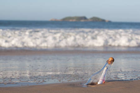 A message inside a glass bottle, washed up on a remote beach. Stock Photo - 14670188
