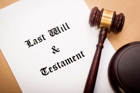 soundboard: A gavel and soundboard on top of a Last Will and Testament contract, with a antique-like background.