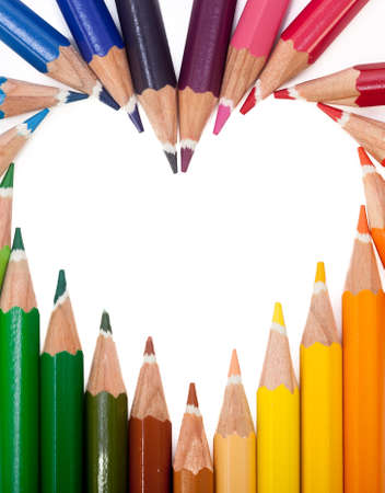 yellow heart: A vivid image with various colored pencils such as yellow, orange, red, pink and blue.
