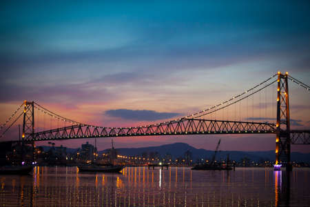 The Hercilio Luz Bridge, in Florianopolis, Brazil, with an amazing sunset.