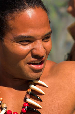 Muscular young Polynesian man wearing a claw necklace