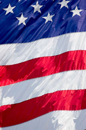 Tightly cropped background photo of the American flag. Imagens