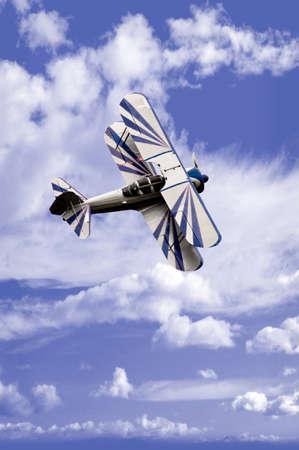 An aerobatic airplane against a cloudy sky