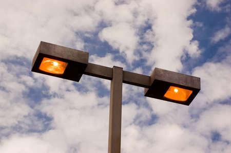 Rectangular parking lot lights coming on at dusk Stock Photo - 1416504