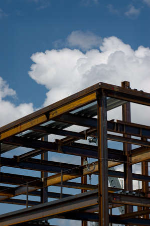 ironworks: The ironworks skeleton of a modern building shot against a cloudy sky. Stock Photo