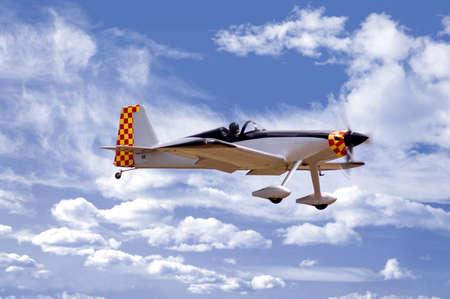 aerobatic aircraft against a cloudy sky