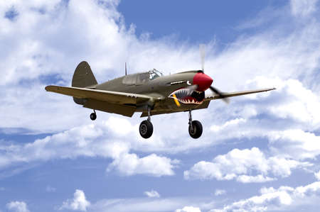 A World War Two U.S. Army Air Corps Curtiss fighter aircraft landing. Stock Photo