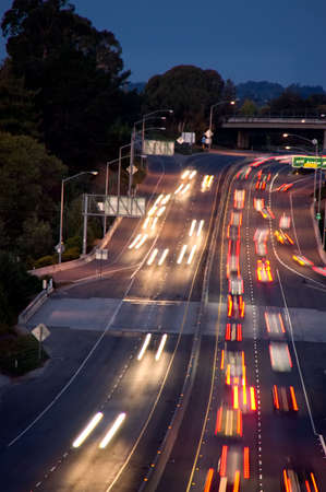 Streaking lights of early morning rush hour cars. Stock Photo