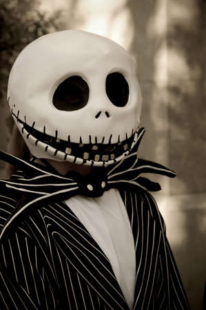 A person wearing a black and white halloween costume.