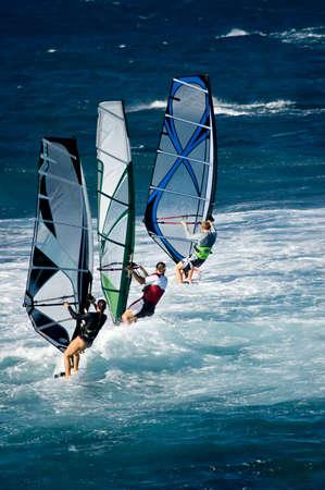 exhilarating: A line of three windsurfers off the coast of Maui