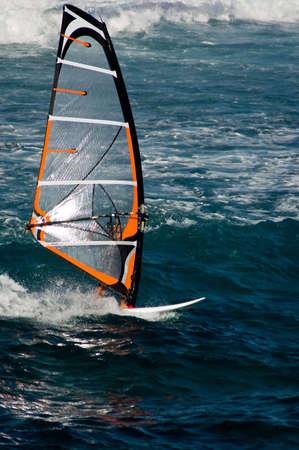 A windsurfer competing at Hookipa Beach Park, Maui.