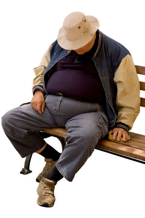 Isolated image of a heavy older gentleman who has fallen asleep on a city bench. Stock Photo
