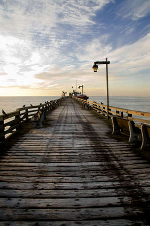 An early morning image of a wharf with frost on the planks. Stock Photo