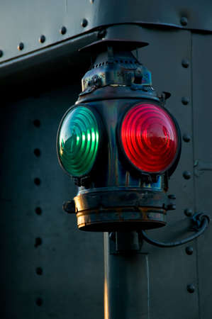 An antique red and green railroad caboose marker lamp photo