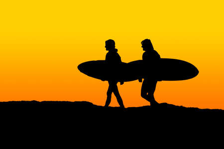 Two men carrying their surfboards and walking toward the ocean Stock Photo - 2673049