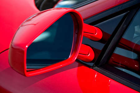 Close up of the side mirror on a sports car