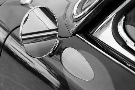 Closeup of the drivers side view mirror on a silver 1967 Porsche 912 coupe