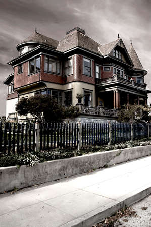 A dramatic image of a Victorian house, processed to give it a foreboding appearance Stock Photo