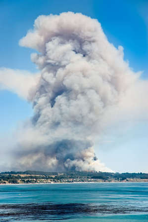Large column of smoke arising from  the Trabing wildfire near Watsonville, California