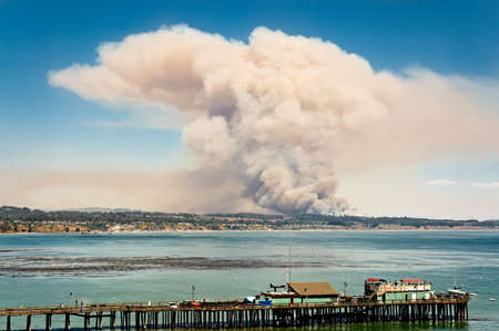 The Trabing wildfire near Watsonville, California, explodes into the sky over the Monterey Bay