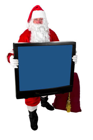 Santa Claus carrying a large television set. Stock Photo