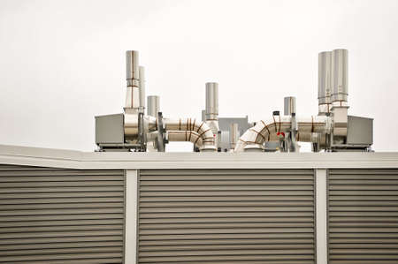 Clean air handling equipment on top of a building with striped panel sides. photo