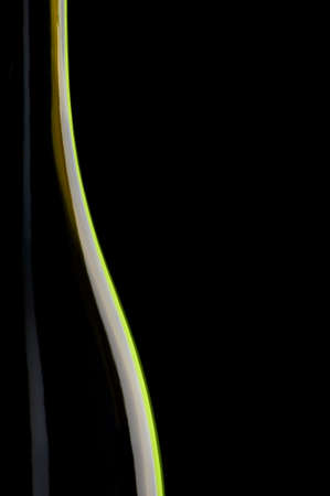 The neck of a bottle of wine on a black background