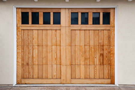 Carriage style garage doors of a contemporary home. photo