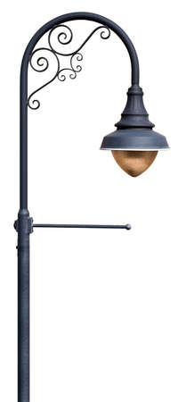 metal post: A post supporting a street lamp, with decorative scrollwork and a place for a banner